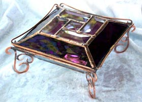 This glass jewelry box has a very special shape and adourned with fancy wirework