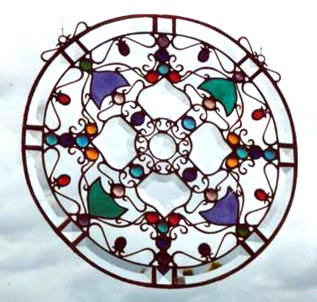 Circle of Life Mandala design has intricate wirework symbolizing that all things come together with grace and harmony.