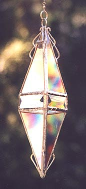 Platonic golden triangles and a beveled band enhance the rainbow effects.