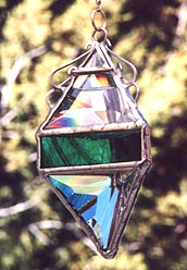 Teal accents enhance this beveled water prism.