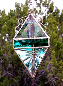 Wavy teal jewel tones accent this large beveled pendant.