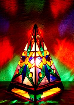 The Anasazi Sun Pyramid Lamp has a Southwestern design and broadcasts in all directions an inspiring light show of luminous colors.