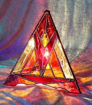 The Sunglow Pyramid Lamp radiates fiery hot colors