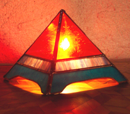 The Fire Glo Pyramid Lamp has a warm radiant glow.